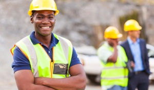 Man smiling on work site