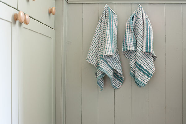 How often should you wash your kitchen towels?