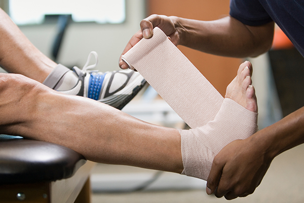 injured foot being wrapped