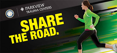 Share the Road graphic with runner