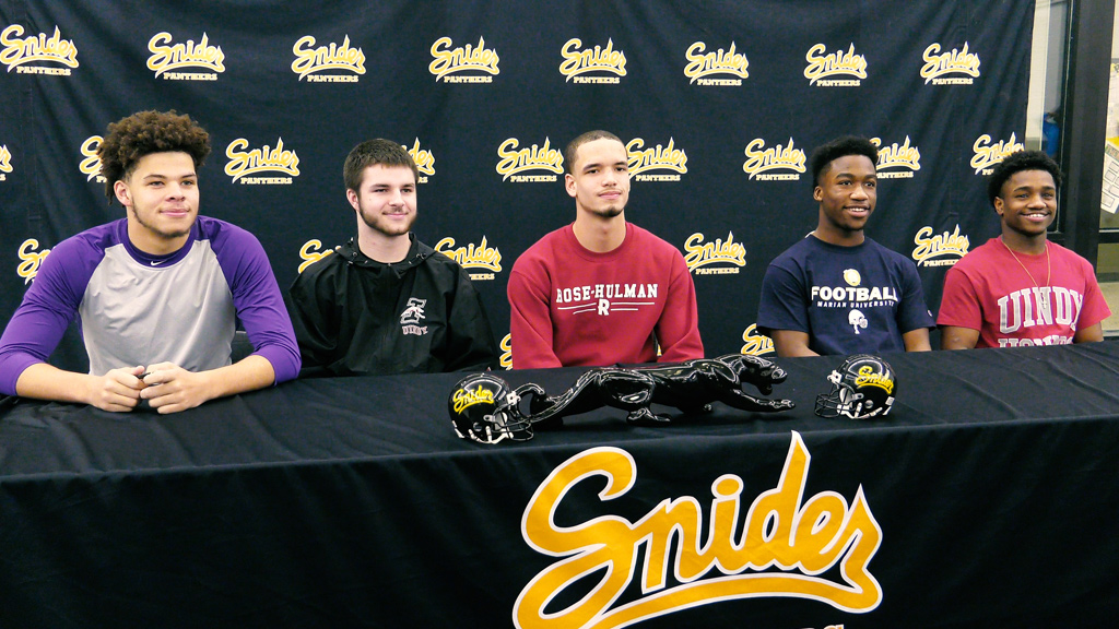 5 Snider football players sign on to college commitments